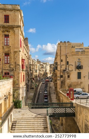 One of the many colorful streets of Valletta  - stock photo
