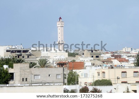 One of the many mosques, across the city Tunis in Tunisia. - stock photo