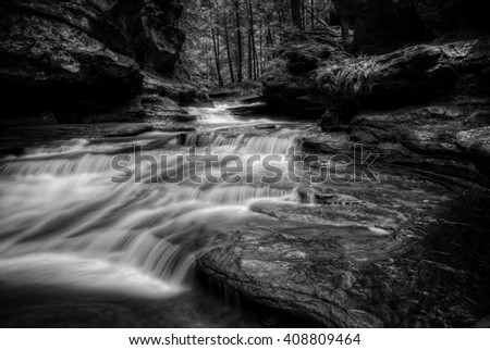 One of the many waterfalls at Old Man's Cave  in Hocking Hills Ohio in black and white. Very popular tourist attraction. - stock photo