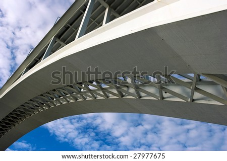 One of the several bridges over Douro river in Porto, Portugal, against blue sky. This one has a very large arch; reinforced concrete - stock photo