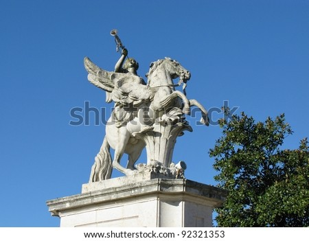 One of the statues at the entrance of the Queluz palace in Portugal - stock photo