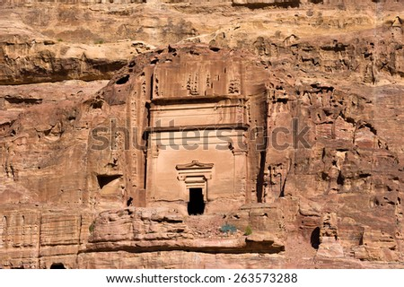 One of the tombs in Petra in Jordan - stock photo