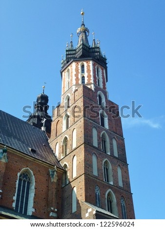 One of the towers of the St Mary church at the market in Krakow in Poland - stock photo