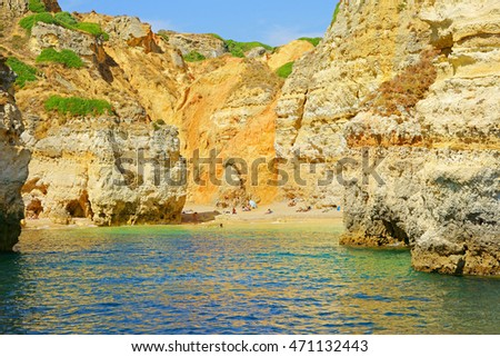 One of the very few and secluded Nudist beaches near Lagos on a summers day, Algarve, Portugal, Europe