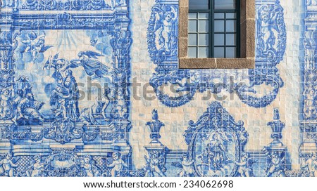 One of the walls of the chapel of Souls in Porto, Portugal. Representing a religious scene with drawn tiles. - stock photo