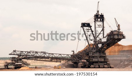 One of the world's largest excavators digging lignite (brown-coal) (lignite) in one of the world's largest mines - stock photo