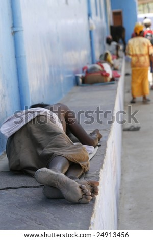 One of thousand's of beggars sleeping on the streets of India