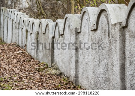 One of two remnants of jewish ghetto wall that helps to remember about sad history. - stock photo