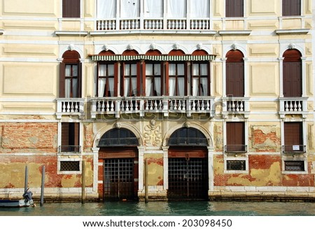 One of Venetian palaces. Architecture details: windows, doors. View on the building from the Grand Canal. - stock photo