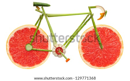 One on the battlefield can still be the best. Road bicycle made of fruits and vegetables on white background. - stock photo