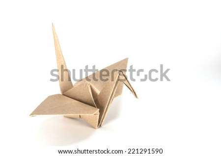 One origami bird : Bird from brown recycle paper with white background - stock photo