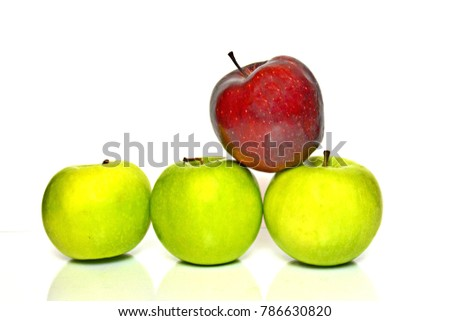one out of four apples is red, the others are green - symbolize to be unique