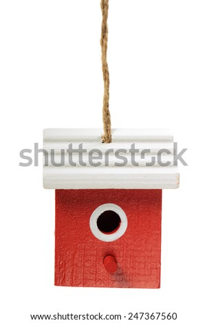 One painted birdhouse hanging on white background - stock photo