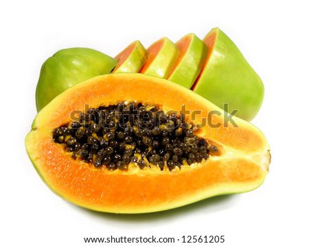 One papaya sliced on half, while another behind is cut on horizontal slices, isolated on a white background.