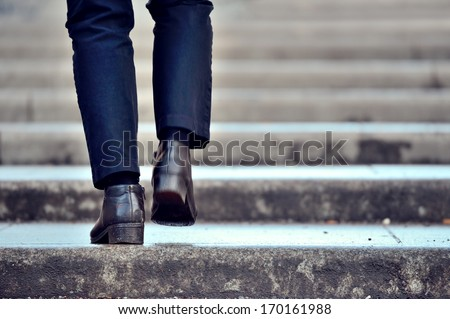 One person in stairs, winter / wet - stock photo