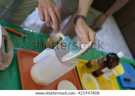one person making a laboratory experiment around a laboratory table with laboratory tools with colorful liquids
