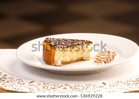 One piece of fresh cheesecake on a white plate