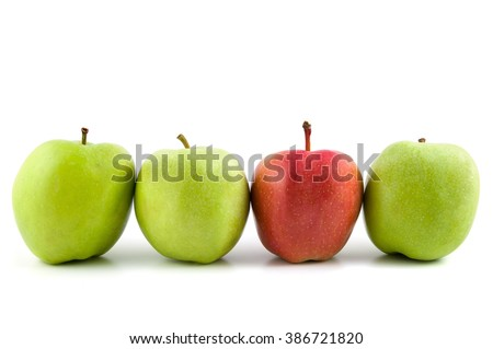 One red apple among green apples isolated on white background with clipping path