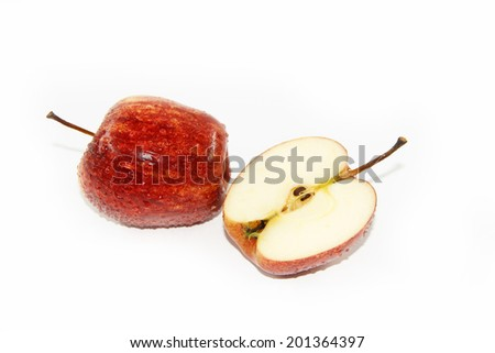 One red apple and slice isolated on a white background