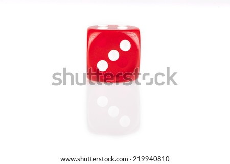 One red dice isolated on white background with reflection - stock photo