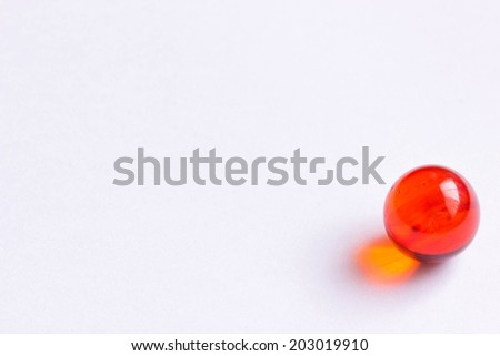 One red glass marble - Lower right - stock photo