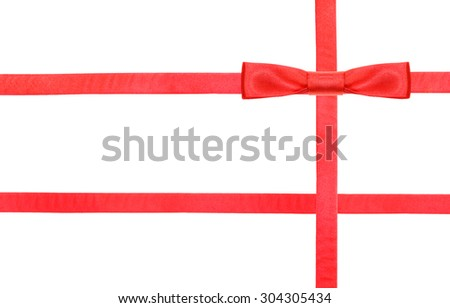 one red satin bow knot in upper right corner and three intersecting ribbons isolated on horizontal white background - stock photo