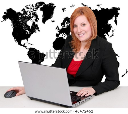 one redhead attractive young businesswoman working on a laptop with full map of the Earth behind her in black - stock photo