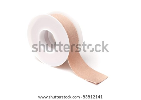 One roll of adhesive patch over white background - stock photo