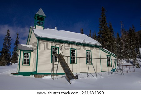 One Room School House and Playground, Montezuma, Colorado with Fresh Snow - stock photo