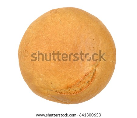 One round loaf of wheat bread. View from above. Isolated on white background.
