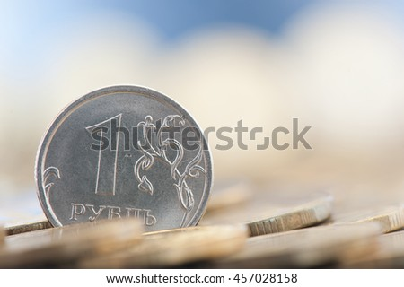 One ruble coin among 10 rubles coins