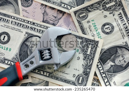 One ruble coin grip in a adjustable wrench. - stock photo