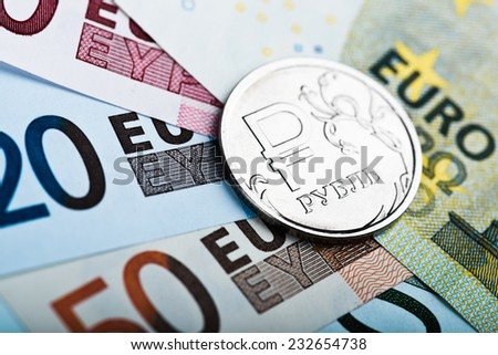 one russian ruble coin on the European banknotes  - stock photo