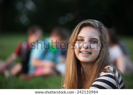 One satisfied teen female with braces on teeth - stock photo
