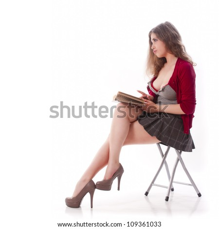 One sexy school girl reading a book
