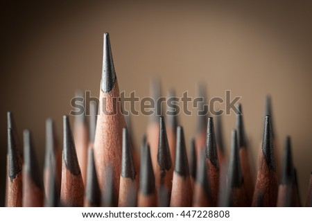 One sharpened pencil standing out from the other  pencil - stock photo