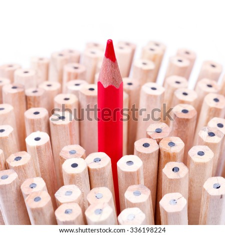 One sharpened red pencil among many onesâ?¨ - stock photo