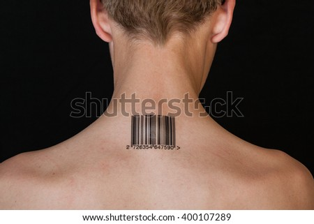 One shirtless and short haired individual stamped with numbered bar code on neck against a black background