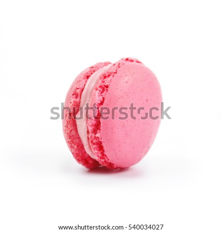 One single pink macaroon isolated on the white background