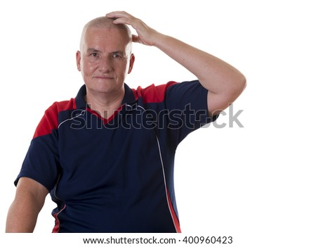 One sitting mature man wearing blue and red shirt with blank stare scratching his head over white background
