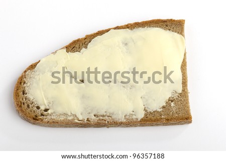 One slice of bread with butter on a white background - stock photo