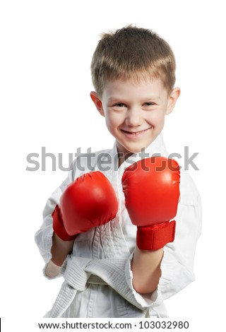 One smiling boy at training exercises in karate kimono with gloves isolated on white