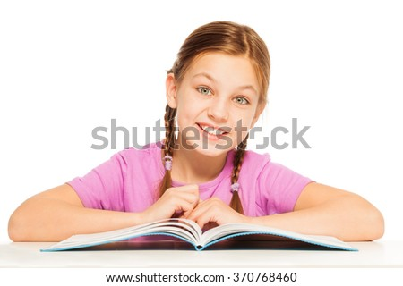 One smiling schoolgirl with her textbook