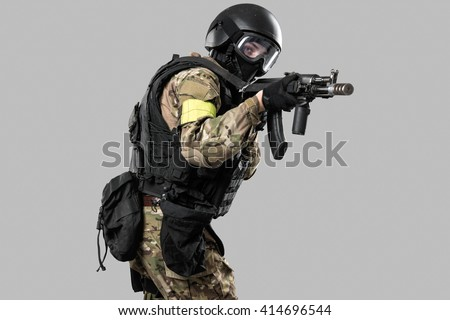 one soldier holding assault rifle ak-74. Uniform conforms to special services FSB of the Russian Federation. Shot in studio. Isolated with clipping path on grey background - stock photo