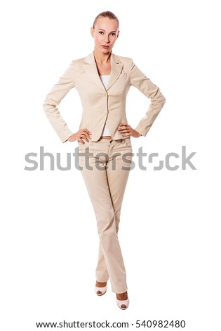 One Standing businesswoman wearing beige suit isolated on white