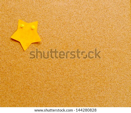 One  star sticky note on cork board