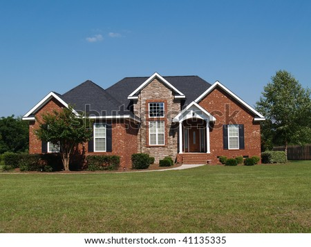 One story new stone and brick residential home. - stock photo
