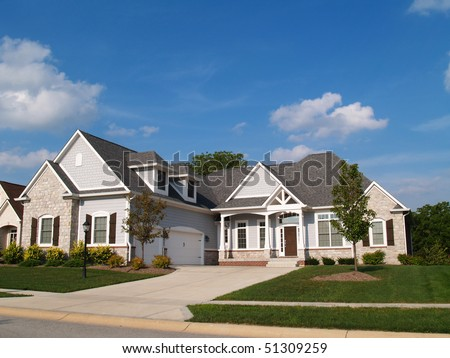 One story vinyl and stone residential home with garage in front containing plenty of copy space, - stock photo