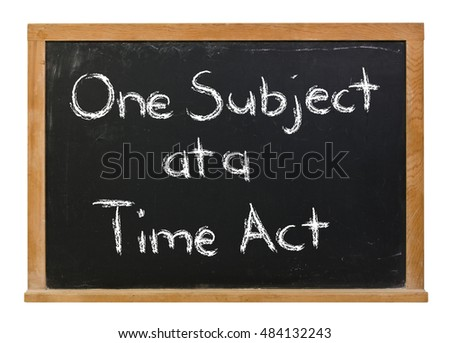 One subject at a time act written in white chalk on a black chalkboard isolated on white