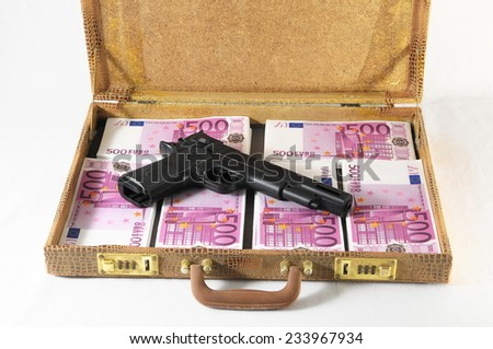 One Suitcase Full of Pink 500 Euros Banknotes and a Gun - stock photo